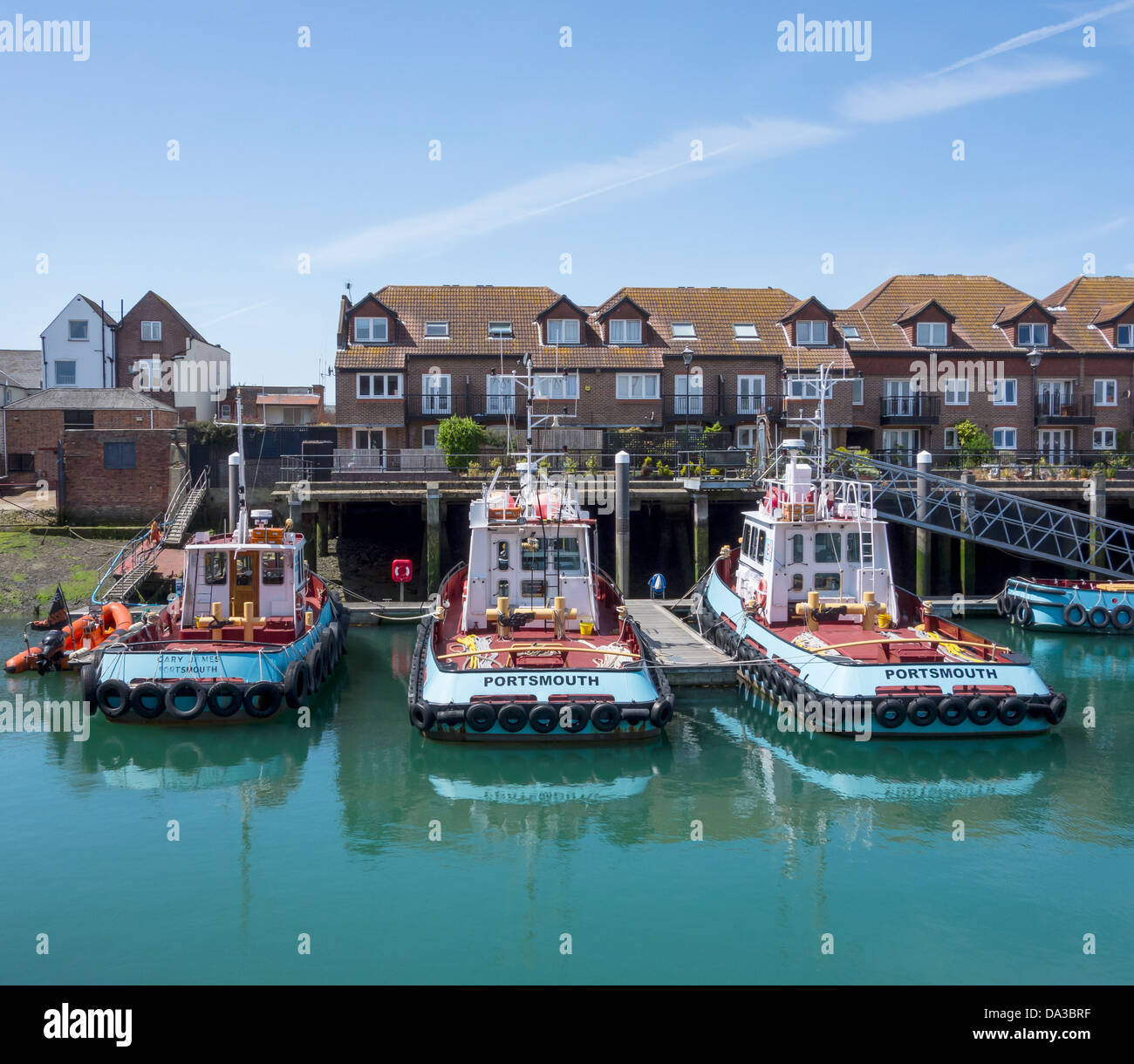 BUTCHERS TUGS in the Camber Dock in Old Portsmouth. The Gary James, the Jack James and the Guy James - Stock Image