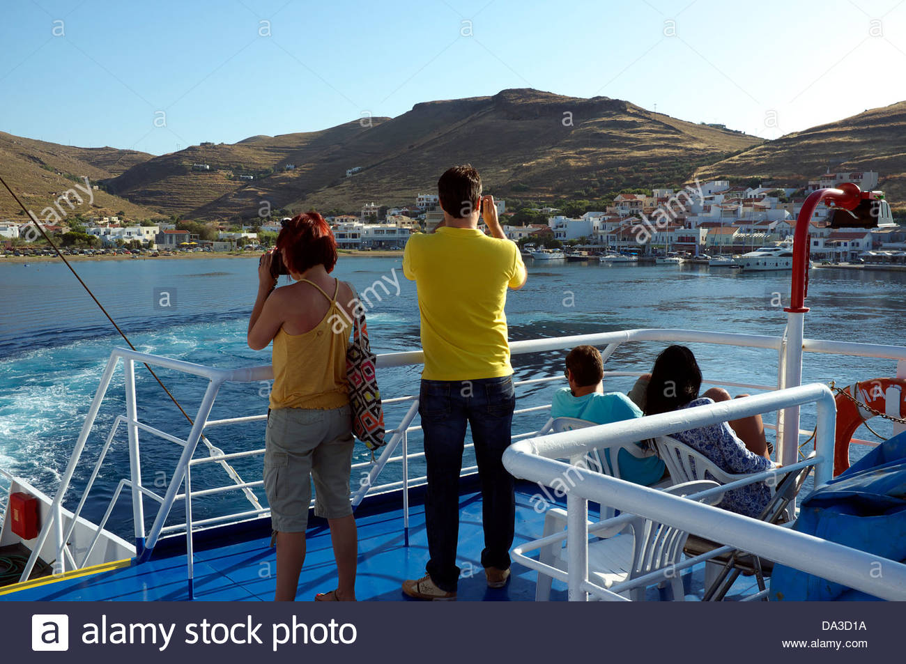 A ferry departs the port of Korissia on Kea island, bound for Lavrio on the Greek mainland. Greece. - Stock Image