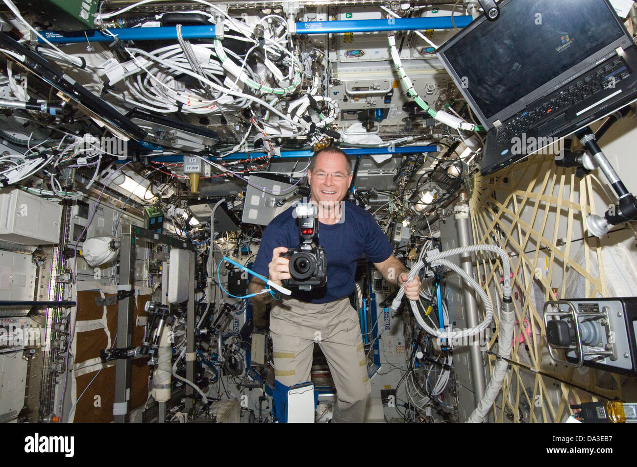Astronaut Kevin Ford in Destiny Laboratory Oct. 26, 2012, Expedition 33 flight engineer holding a still camera ISS - Stock Image