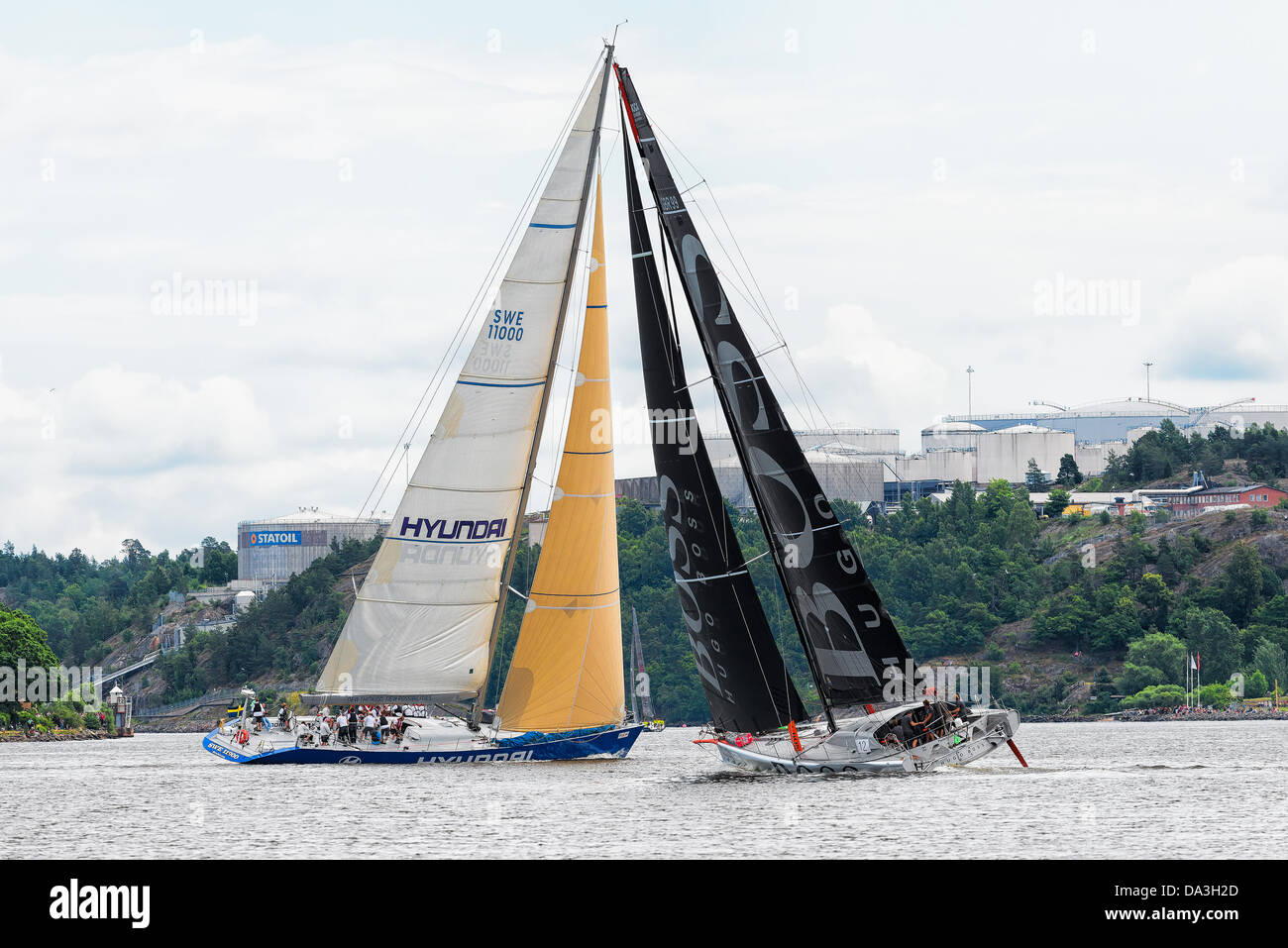 Stockholm, Sweden. 30th June, 2013. Sailboat HUGO BOSS in a faceoff with sailboat HYUNDAI in the depart from Stockholm - Stock Image