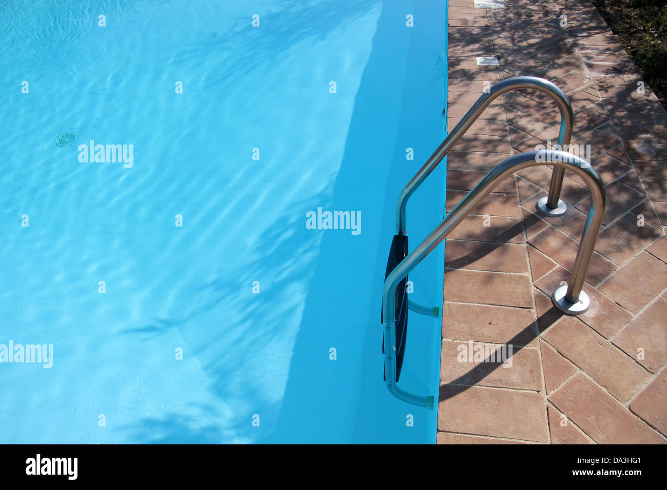 Water reflections in the swimming pool on a sunny day - Stock Image