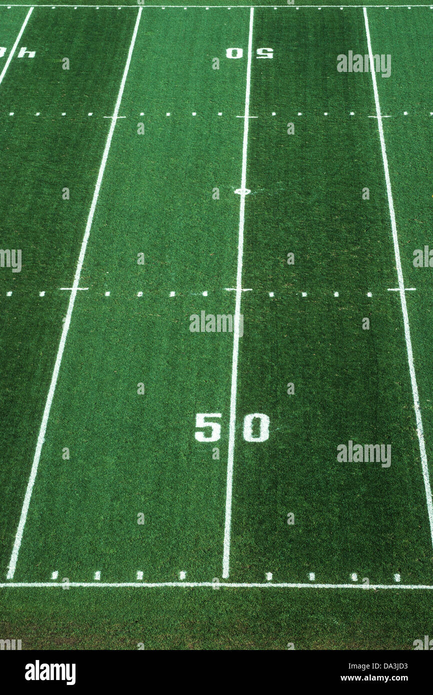 50 yard line on American Football field. - Stock Image