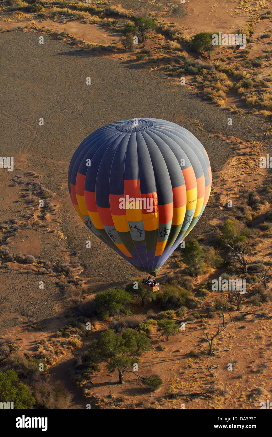 Hot air balloon over Namib Desert, near Sesriem, Namibia, Africa - aerial - Stock Image