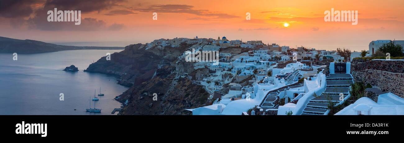 Panorma of the sun settings over Oia on the Island of Santorini Greece. - Stock Image