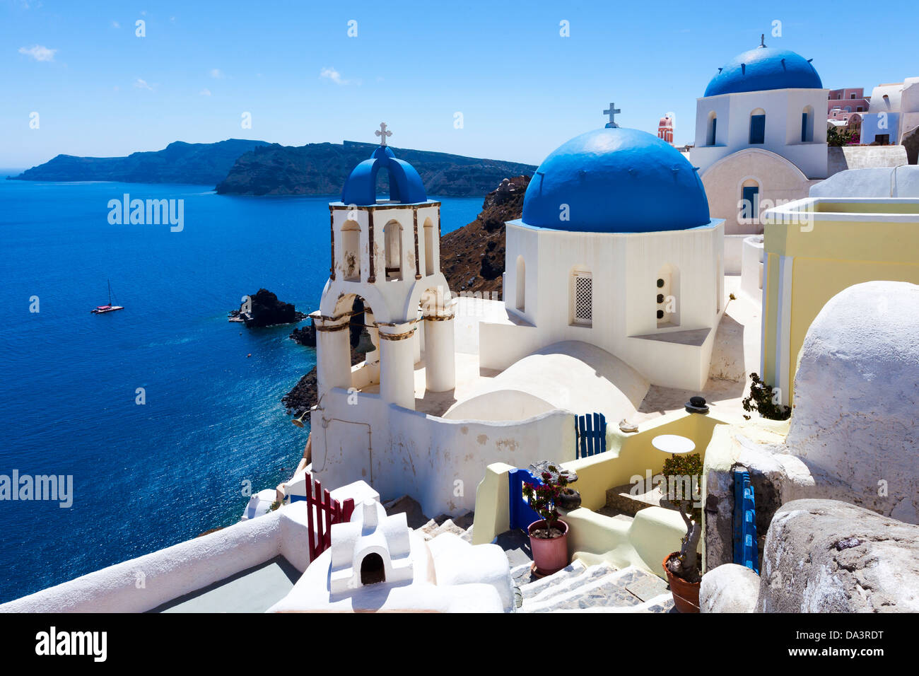 Blue domed churches on the Caldera at Oia on the Greek Island of Santorini. - Stock Image