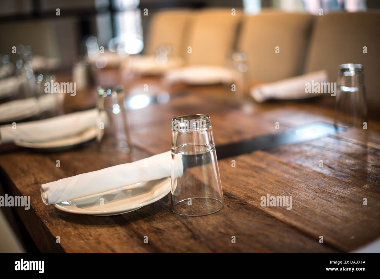 A Simple Table Setting In A Restaurant On A Solid Wooden Table.   Stock  Image