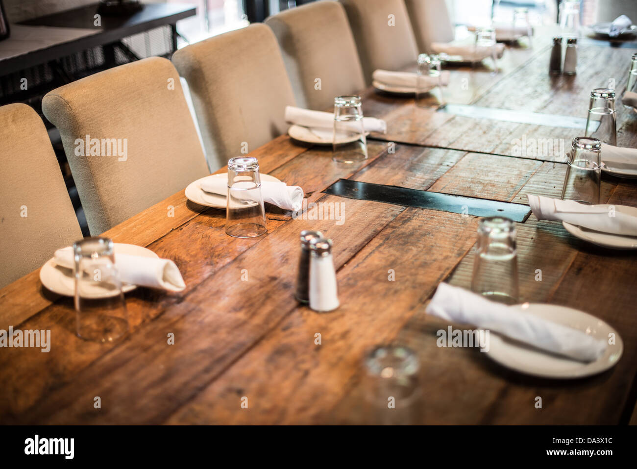 A simple table setting in a restaurant on a solid wooden table Stock ...