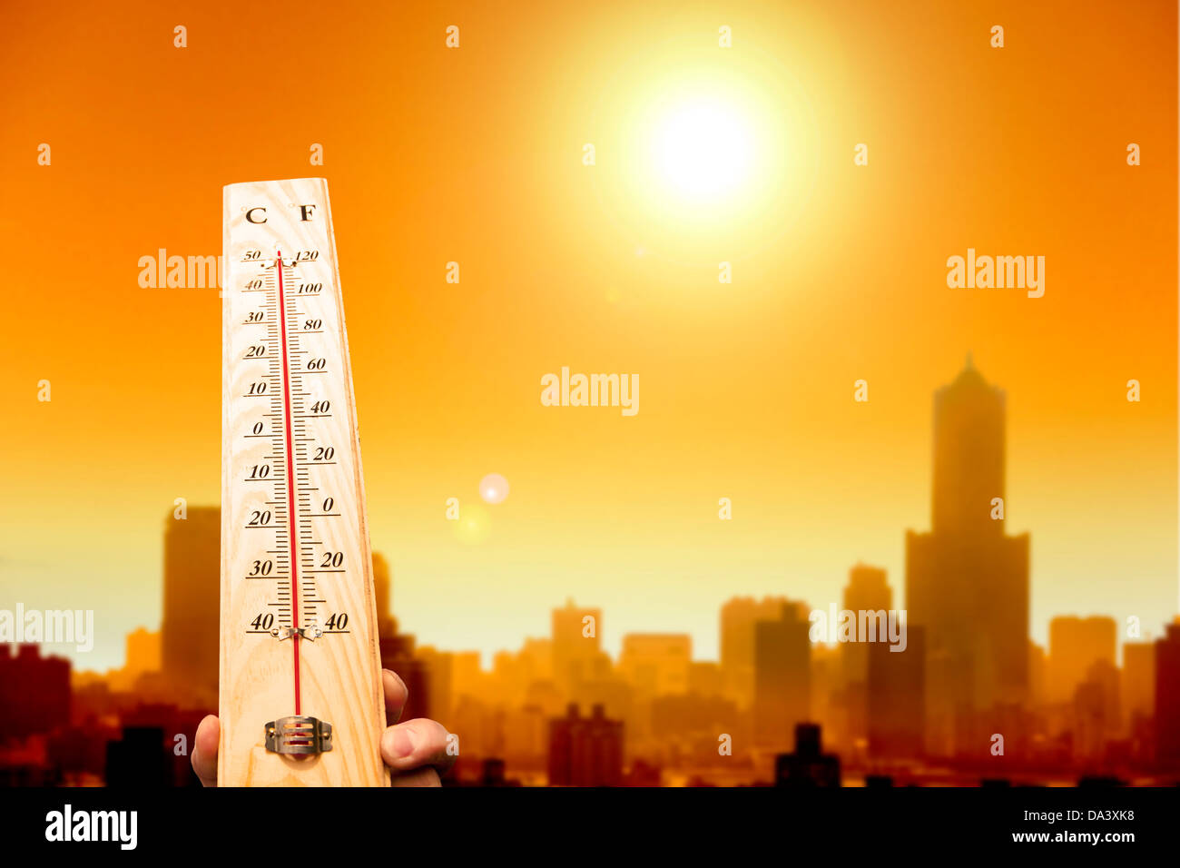 heat wave in the city and hand showing thermometer for high temperature Stock Photo