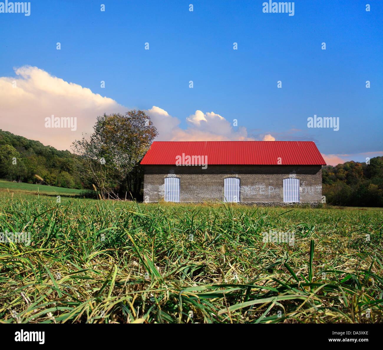 An Abandoned Brick Barn And Pastureland Photographed At Ground Level, Southwestern Ohio, USA - Stock Image