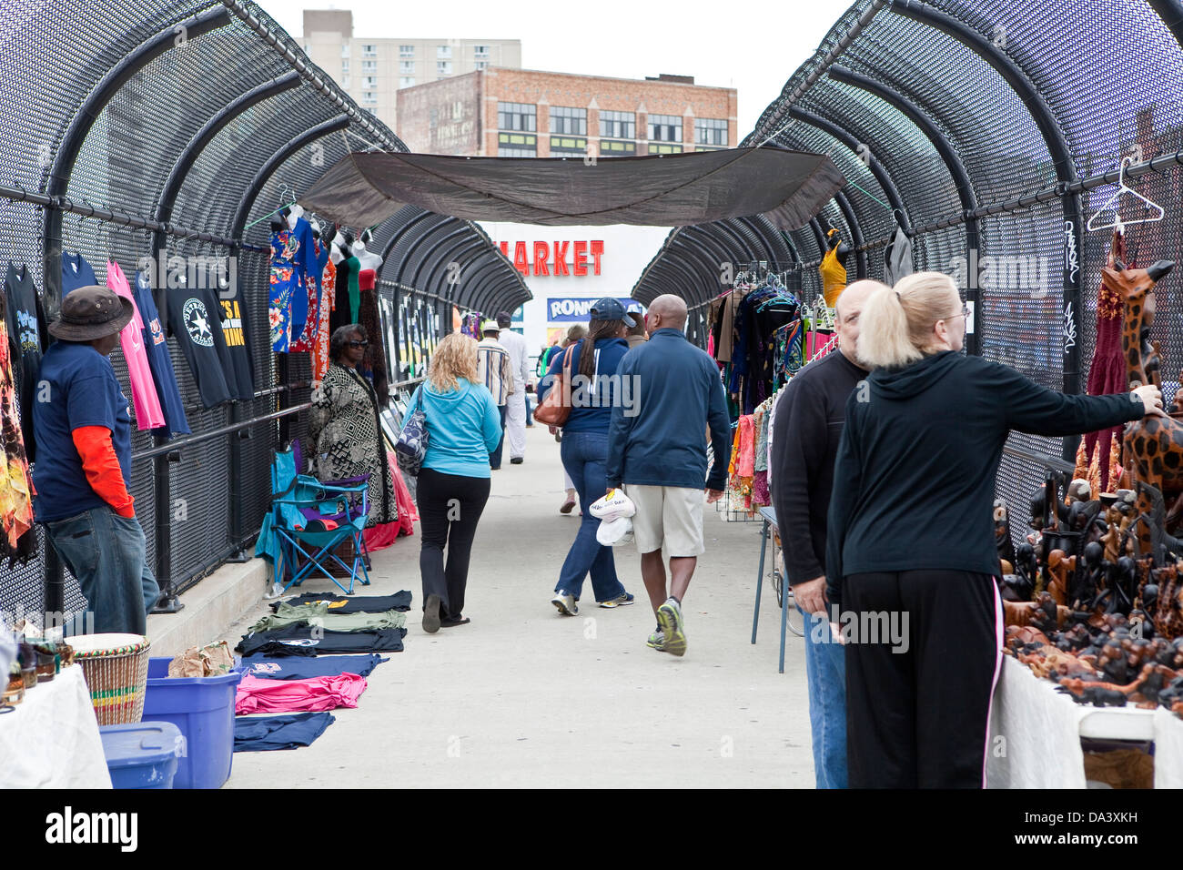 A woman peruse a stall of the Detroit Eastern Farmers market on an highway overpass in Detroit (Mi) - Stock Image