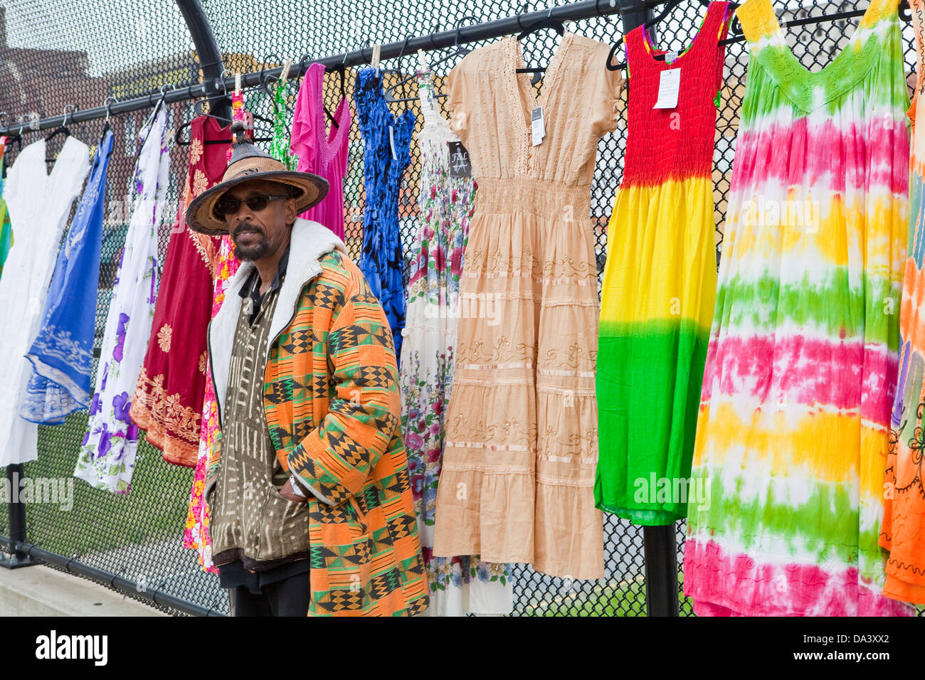 A Vendor selling colourful cloths is seen on an highway overpass at the Detroit Eastern Farmers market in Detroit - Stock Image