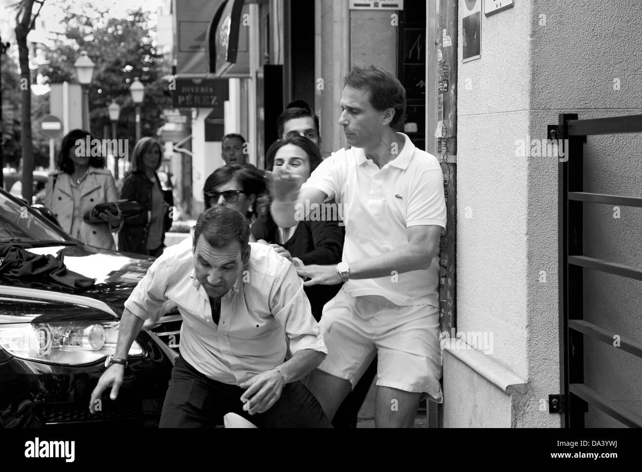 Street brawl, Madrid, Spain - Stock Image