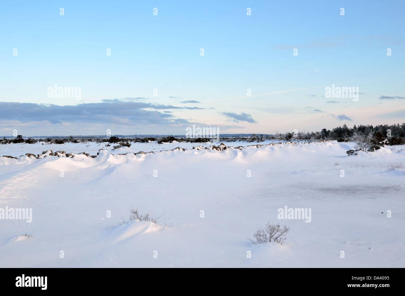 Snowdrift at stonewall - Stock Image