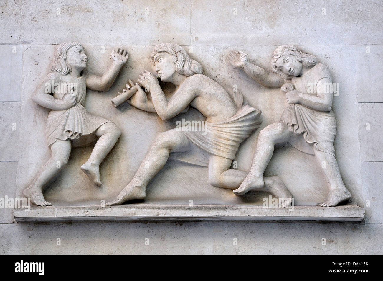 """London, England, UK. Broadcasting House (home of the BBC) """"Ariel piping to children"""" by Eric Gill - Stock Image"""