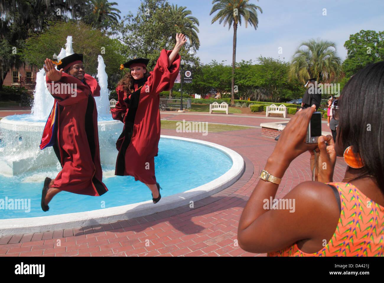 Graduation Gown Posing Taking Black Stock Photos & Graduation Gown ...