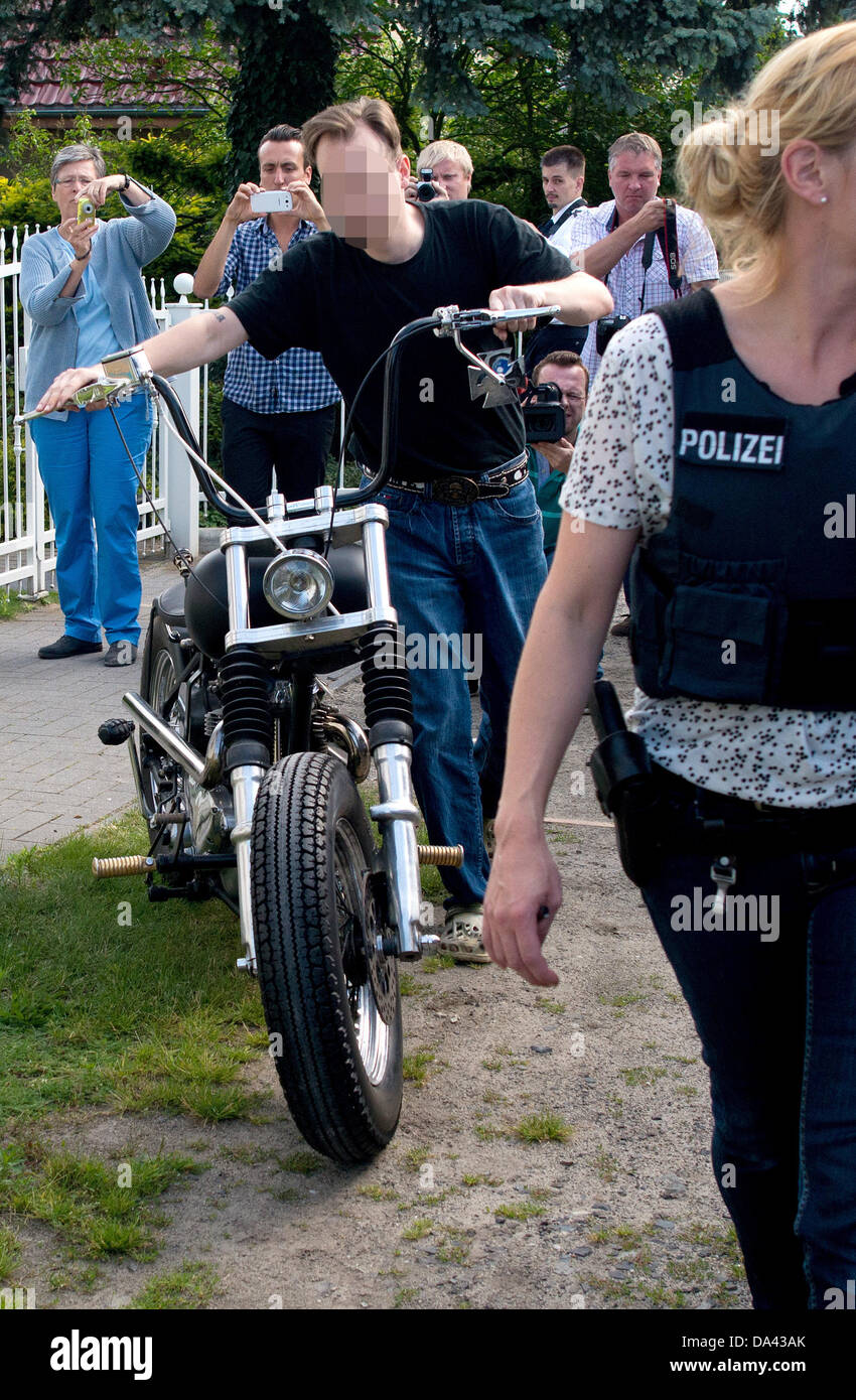 A member of the motorcacle club 'Regional Association Gremium Motorcycle Club (MC) Saxony' pushes his motorcycle, - Stock Image