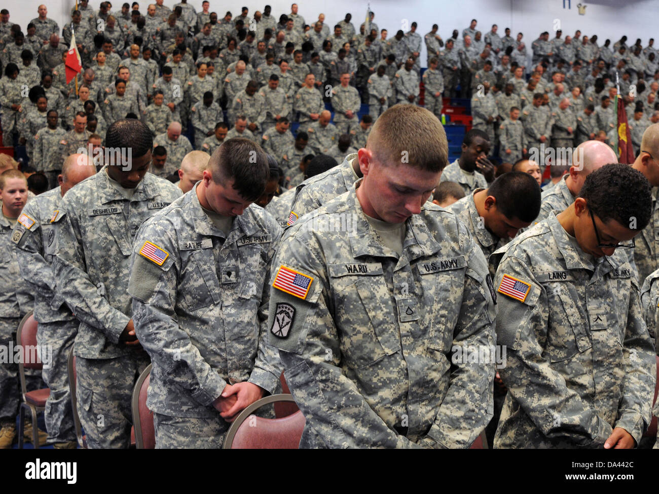 US Army soldiers bow their heads for prayer during Wrangler