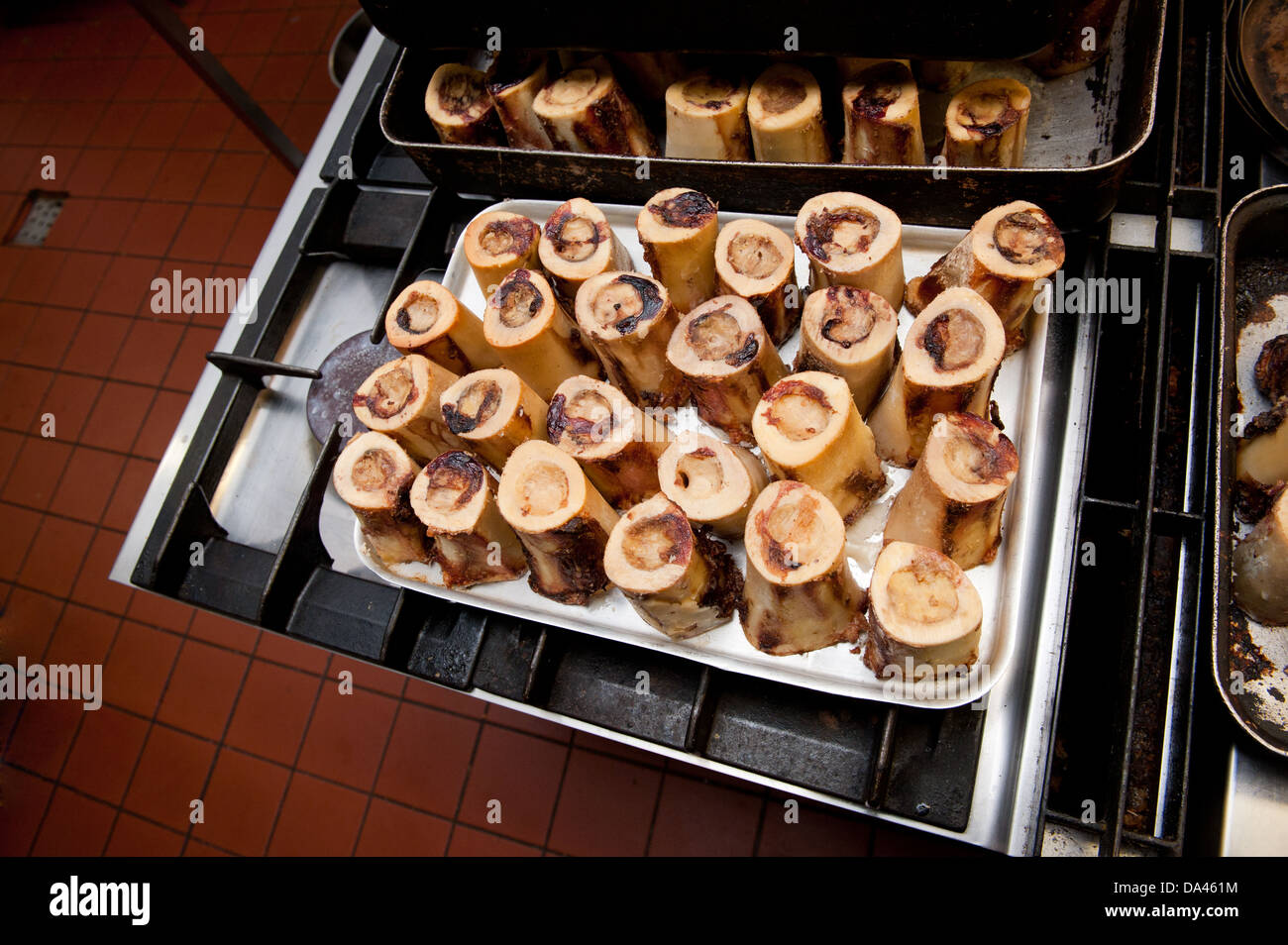 Roast Bone Marrow on a Baking Tray in Kitchen Setting Stock Photo