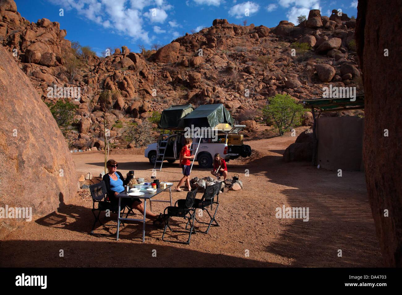 Family camping at Mowani Mountain Camp, near Twyfelfontein, Damaraland, Namibia, Africa Stock Photo
