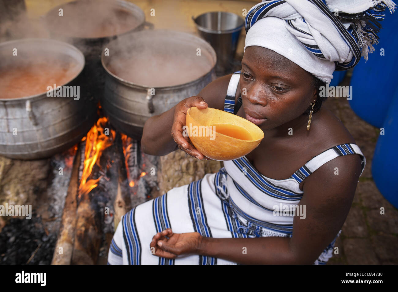 Master brewer from Burkina Faso, Ine Kam, samples her millet beer at the brewery of Weissenohe Abbey in Weissenohe, - Stock Image