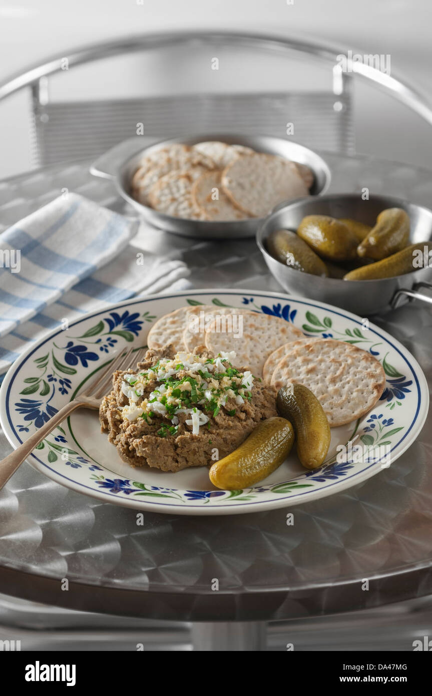 Chopped liver with matzo crackers and pickles Stock Photo