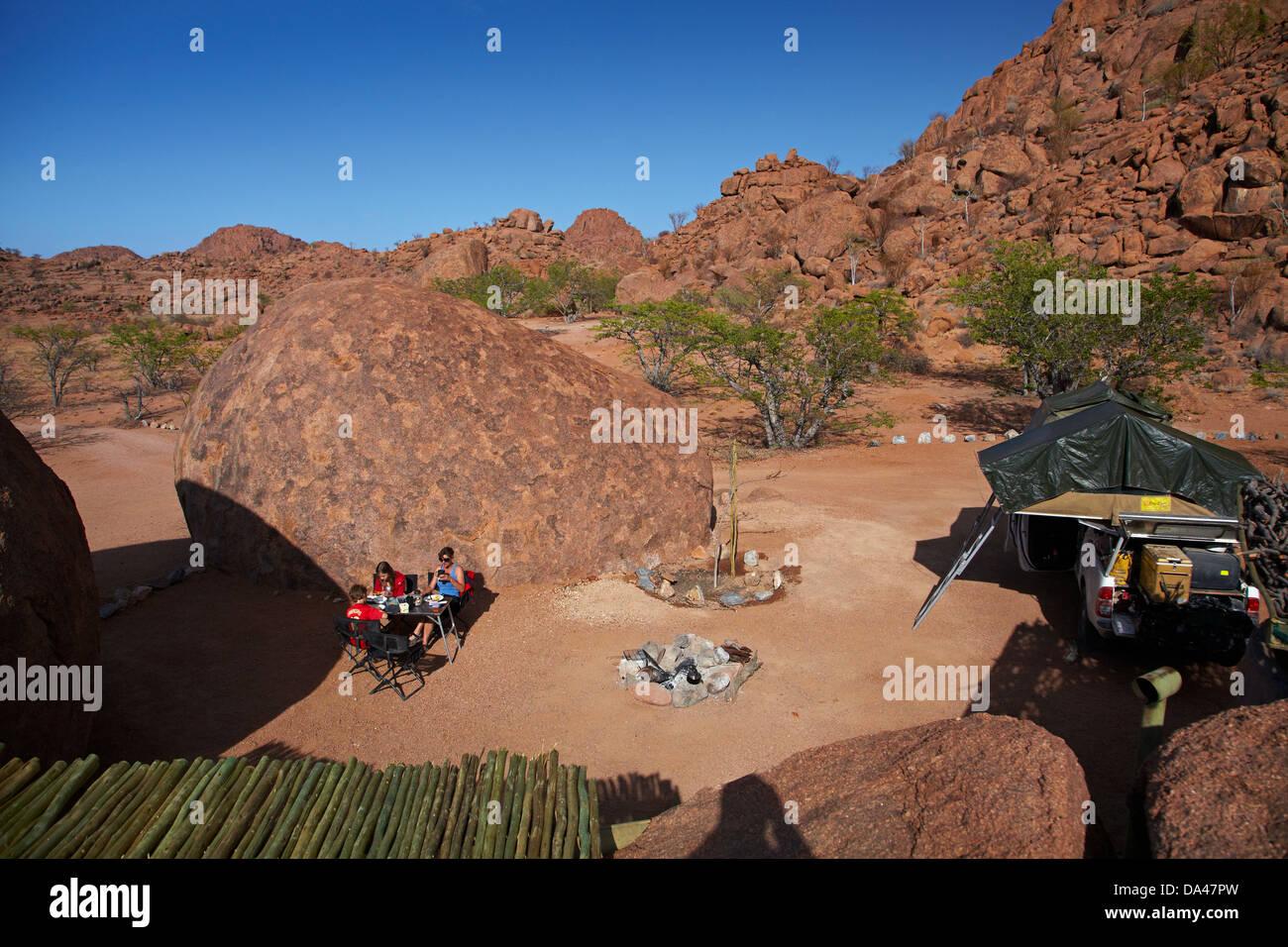 Family camping at Mowani Mountain Camp, near Twyfelfontein, Damaraland, Namibia, Africa - Stock Image