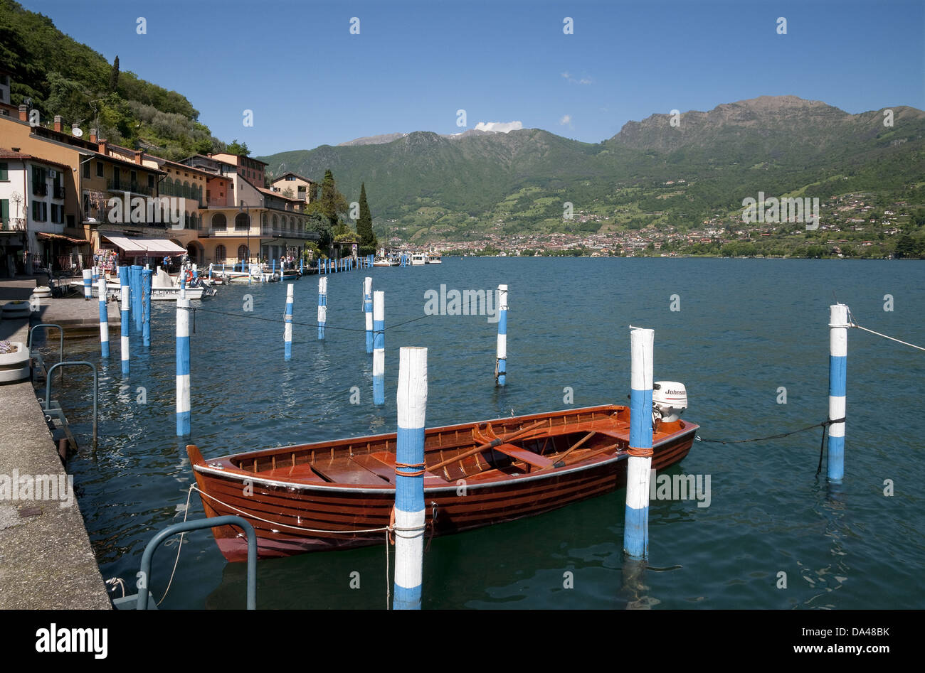 Boats in harbour of town on lake island, Peschiera Maraglio, Monte Isola, Lago d'Iseo, Lombardy, Italy, May Stock Photo