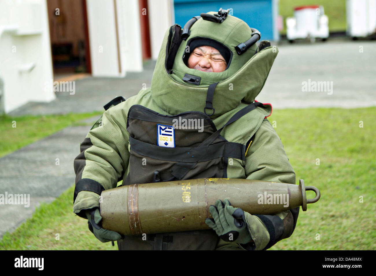 Japan Ground Self-Defense Force soldier Sgt. Maj. Arata Hamaguchi participates in simulated explosive ordnance disposal - Stock Image