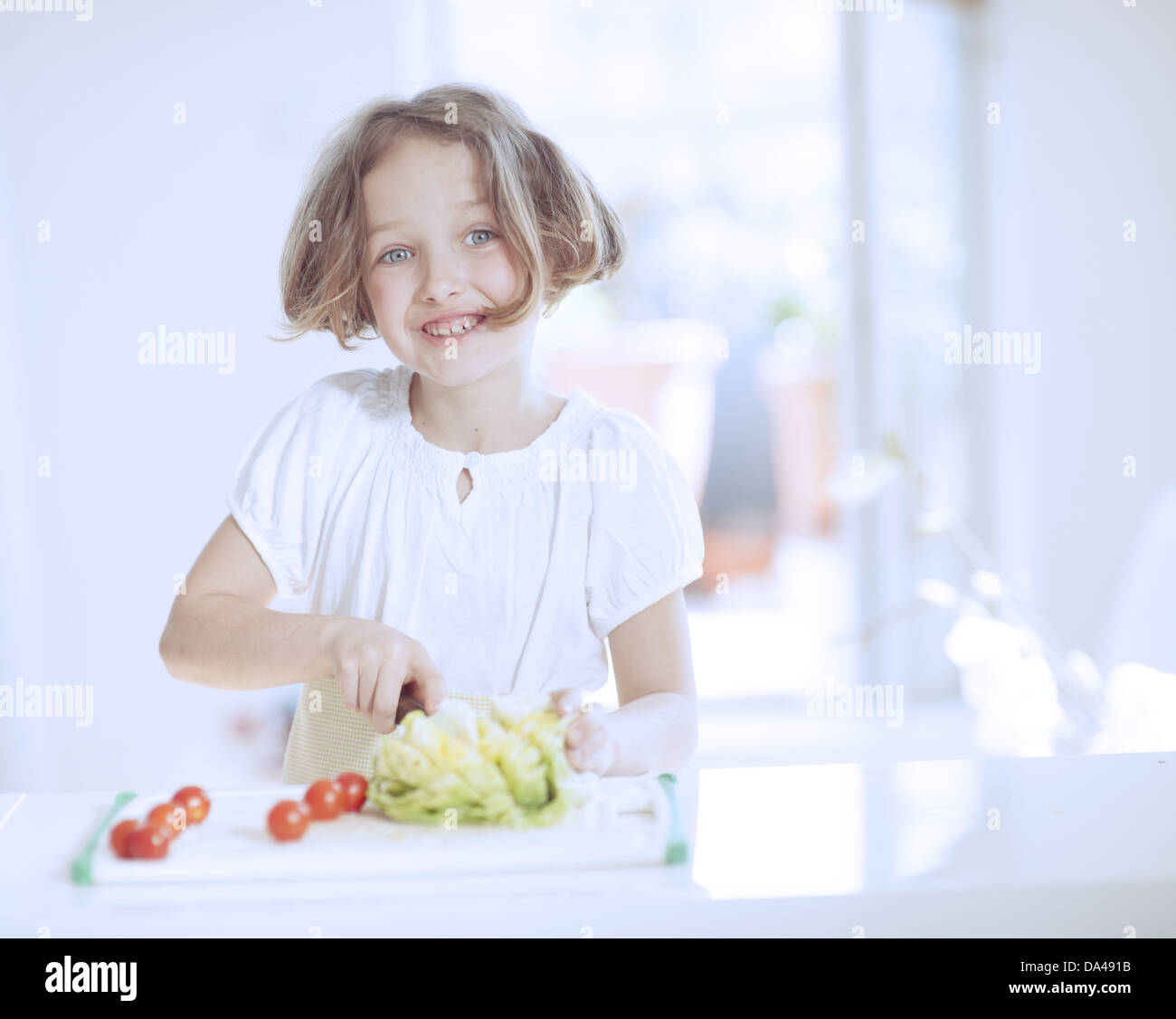 Young girl making a salad - Stock Image