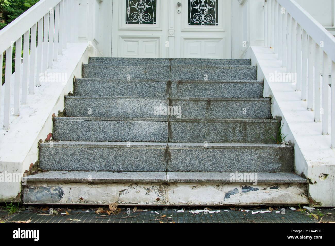 damaged stairway to door - Stock Image