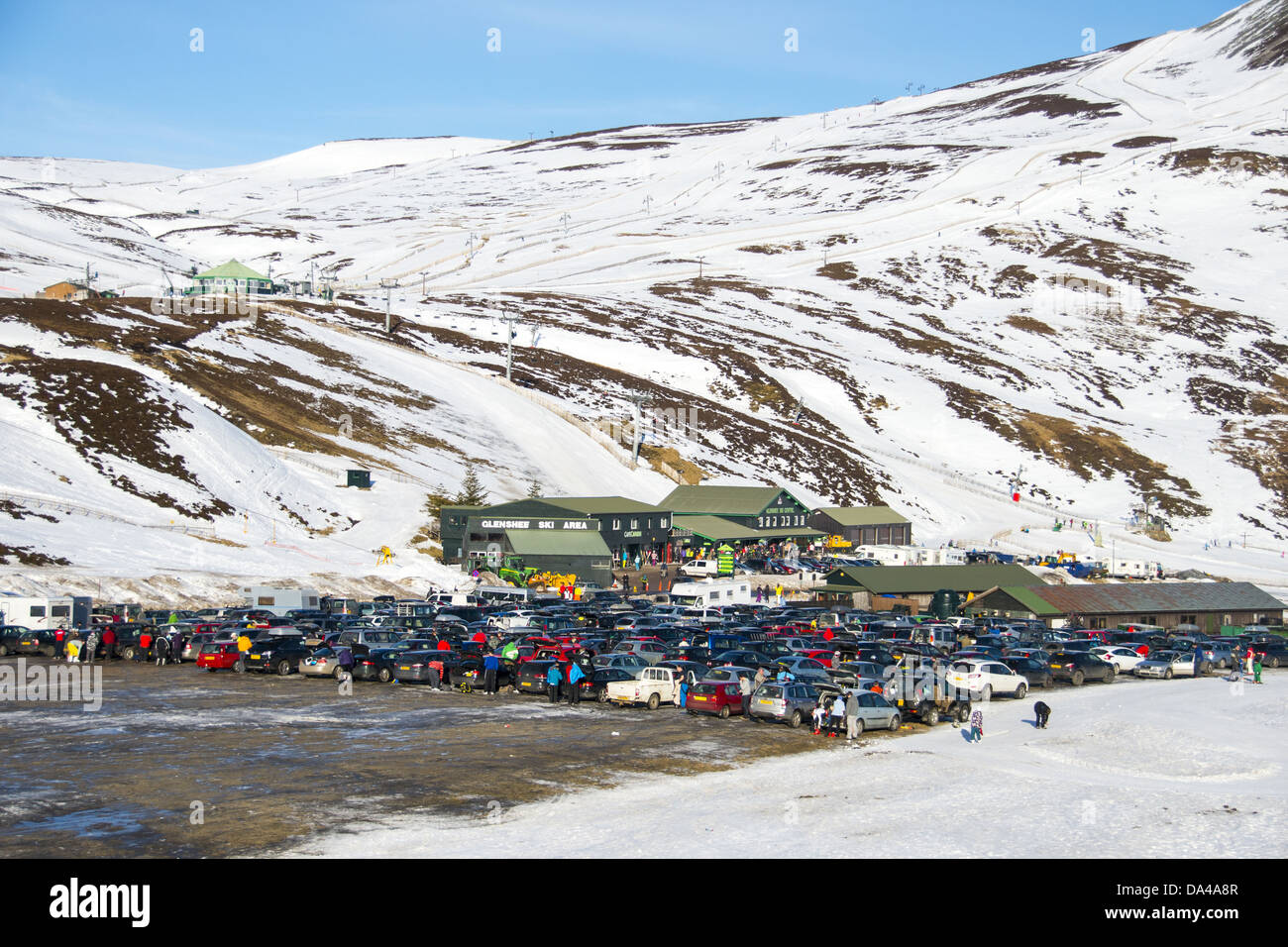 ski resort carpark buildings and chairlift in snow glenshee ski