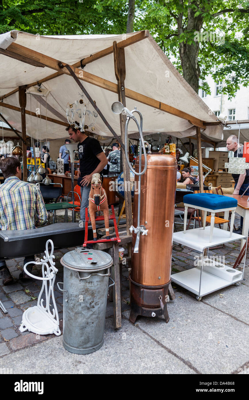 Old copper water heater (geyser) and shower at a fleamarket, Mitte, Berlin - Stock Image