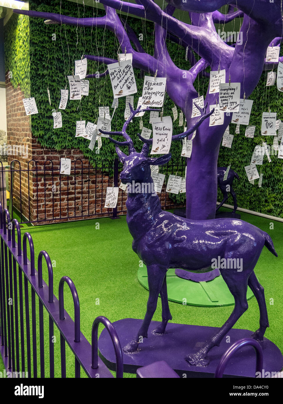Messages from wellwishers adorn a purple tree a departure lounge of Heathrow airport Terminal 1 after the  2012 - Stock Image
