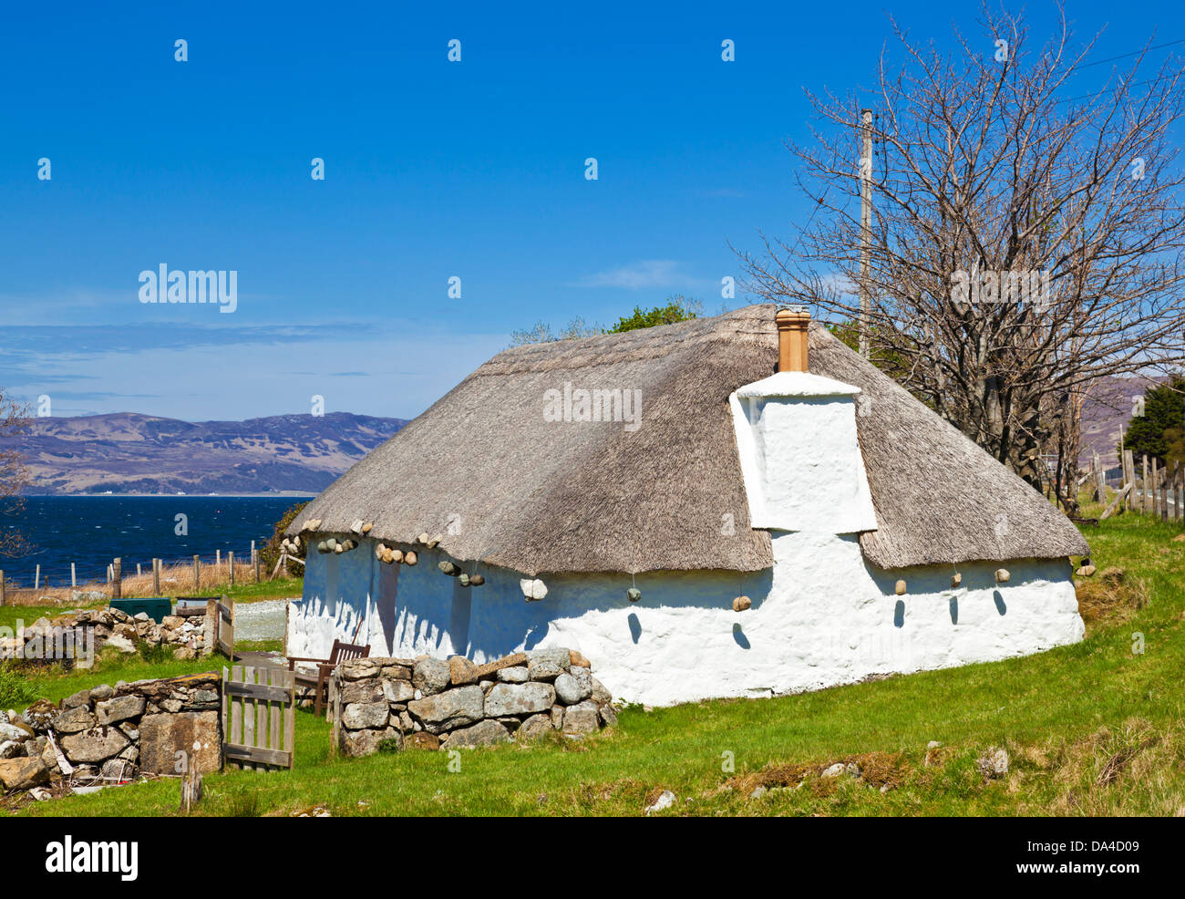Old fashioned traditional thatched roof cottage on the Isle of Skye Highlands and islands Scotland UK GB EU Europe - Stock Image