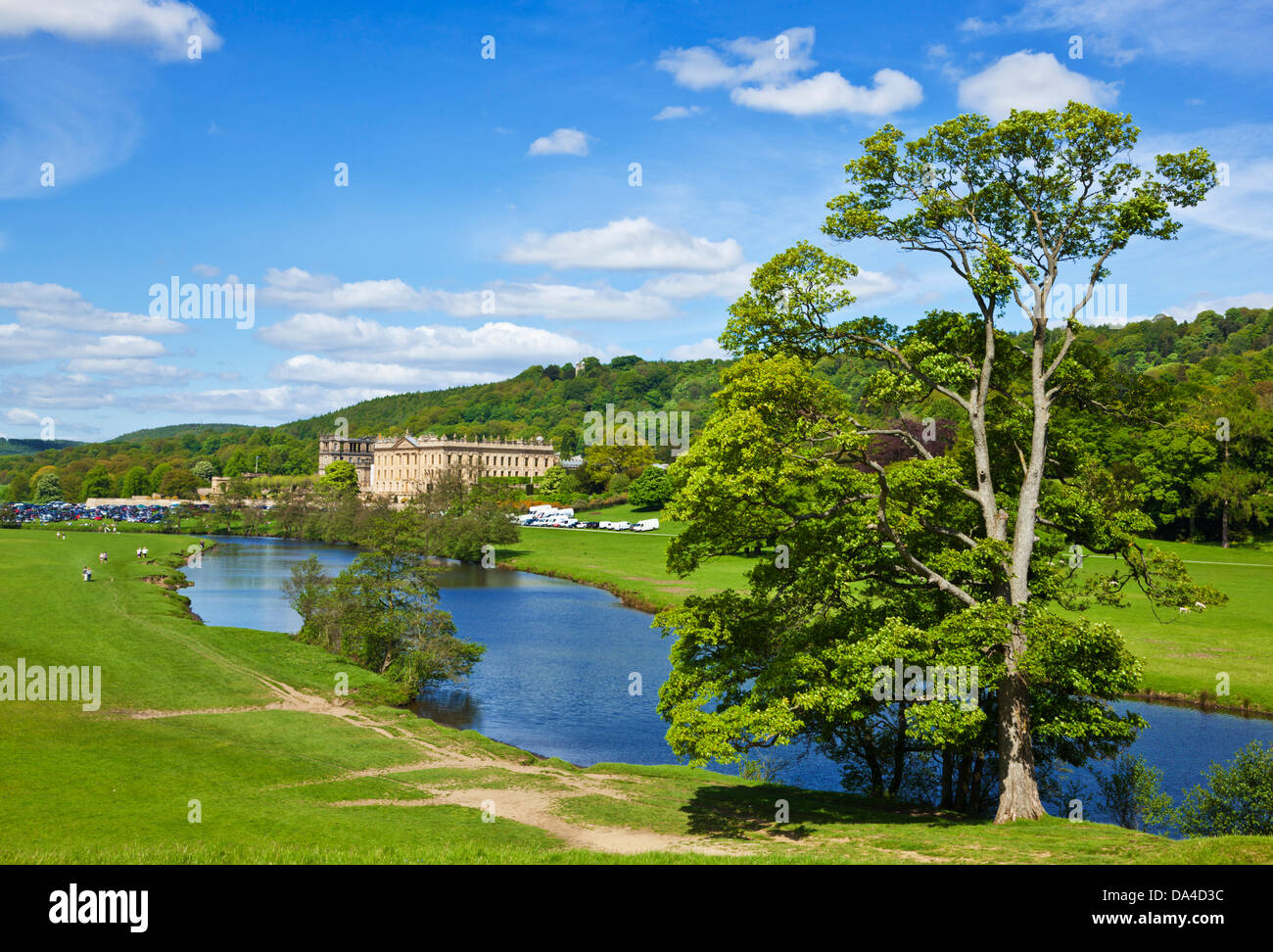 Chatsworth House park with river Derwent parkland and woods Derbyshire, England, UK, GB, EU, Europe - Stock Image