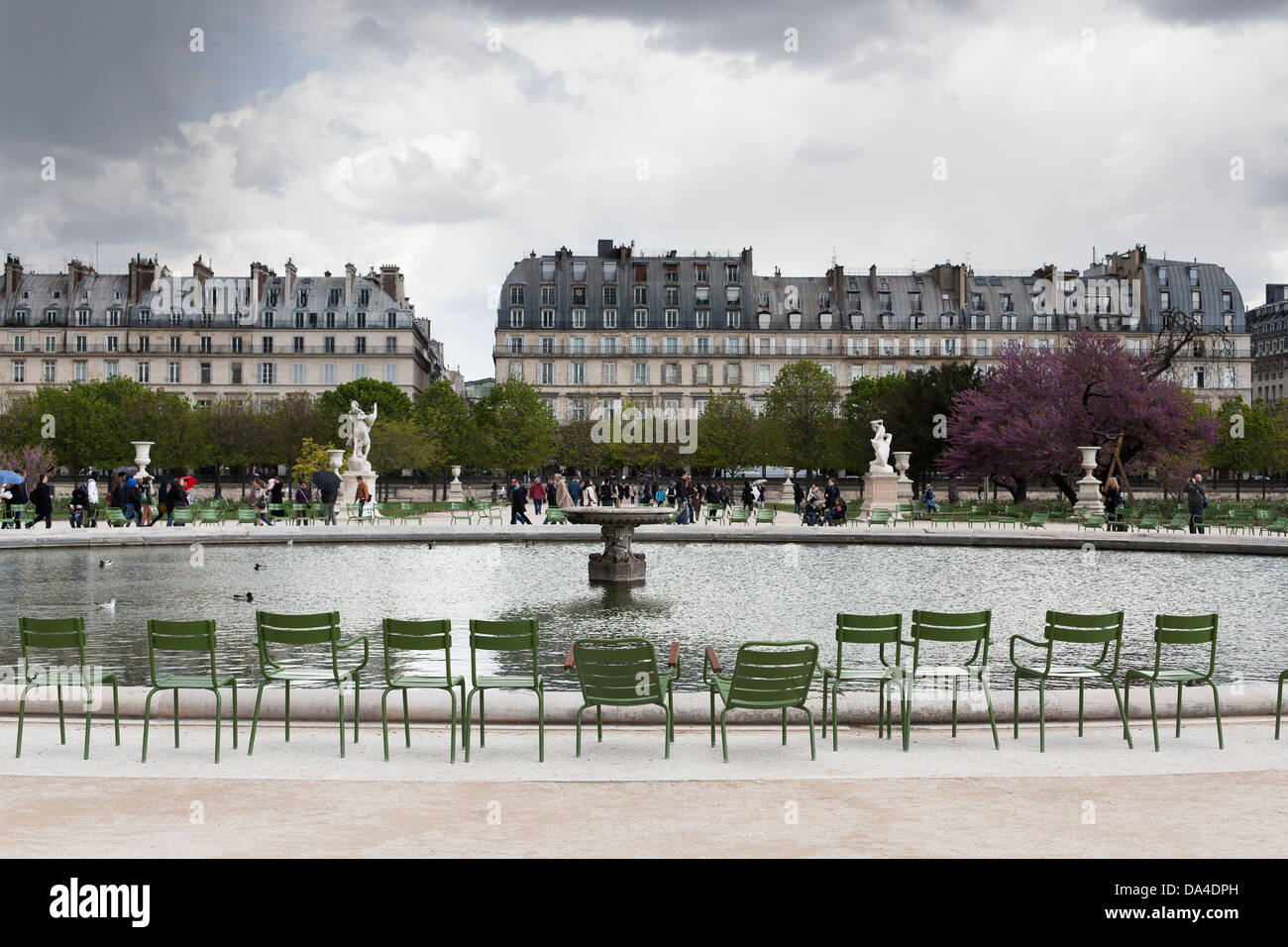 Empty chairs by Grand Bassin Octagonal in the Tuileries Garden - Stock Image