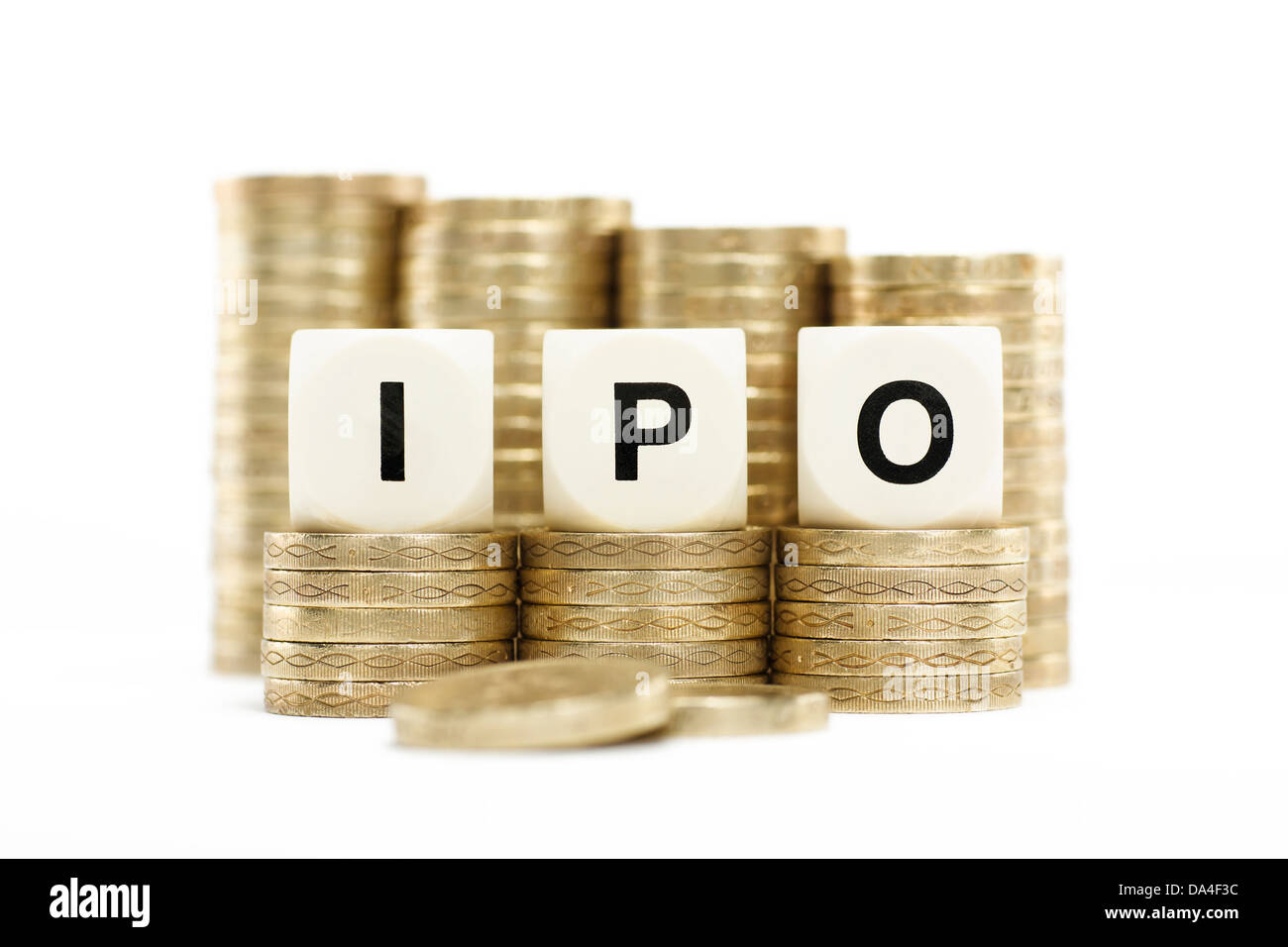 IPO (Initial Public Offering) on gold coins on white background - Stock Image