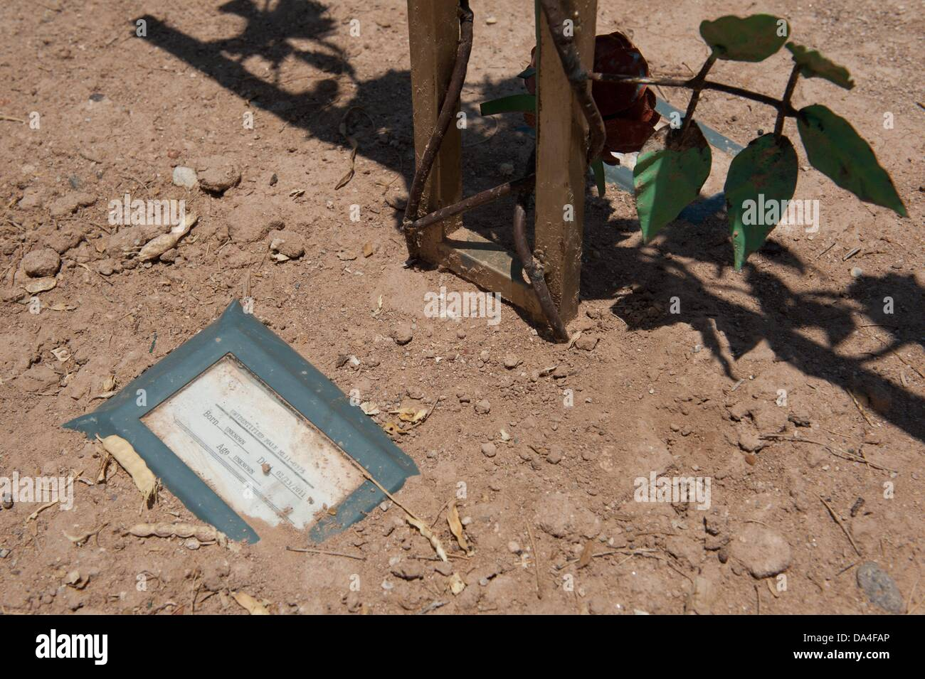 July 2, 2013 - Tucson, Arizona, United States - A paper marker indicates the grave of ''Unidentified Male - Stock Image