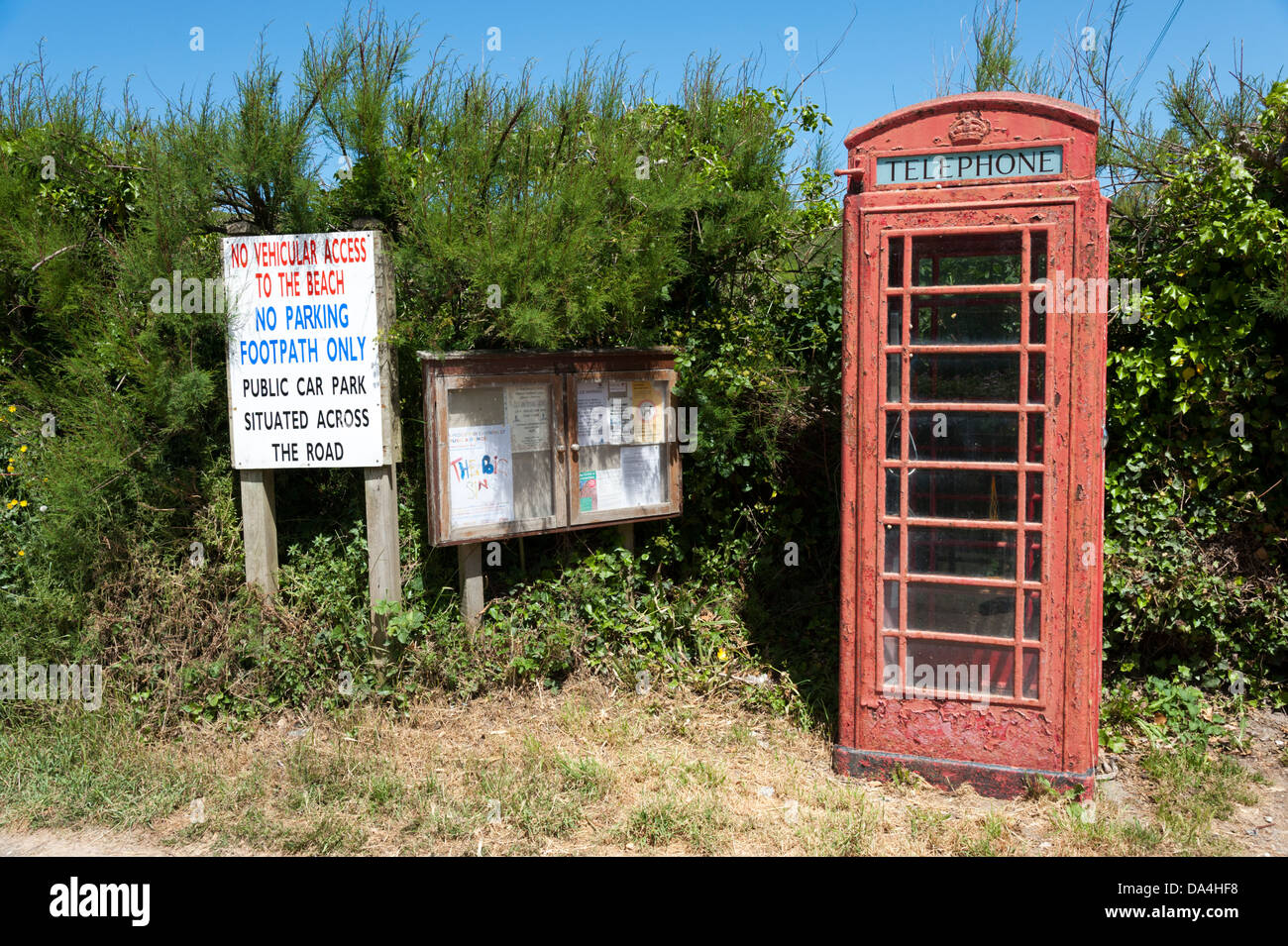 The traditional red telephone box at Porthcothan Bay Cornwall UK - Stock Image