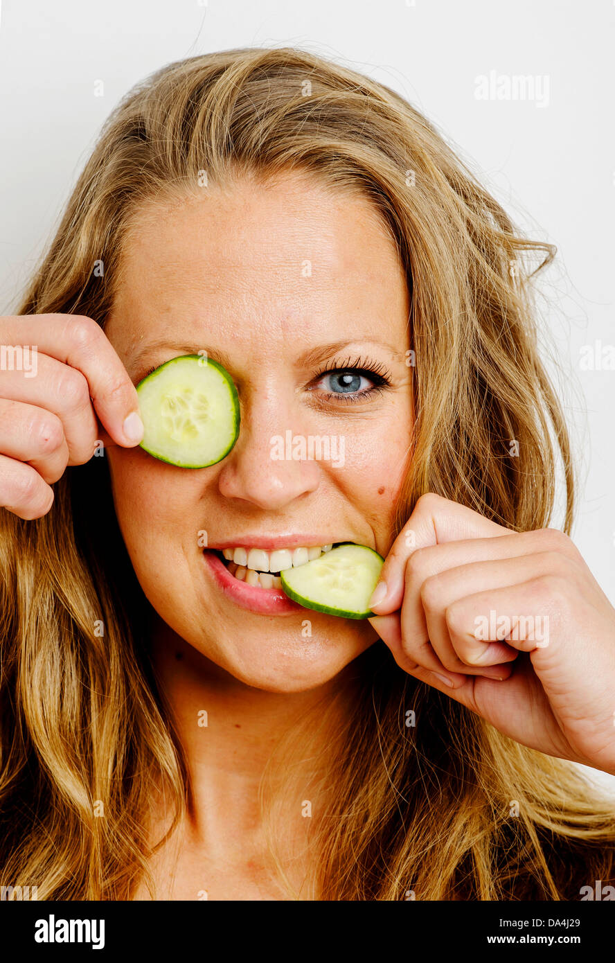 Girl Playing With Cucumber