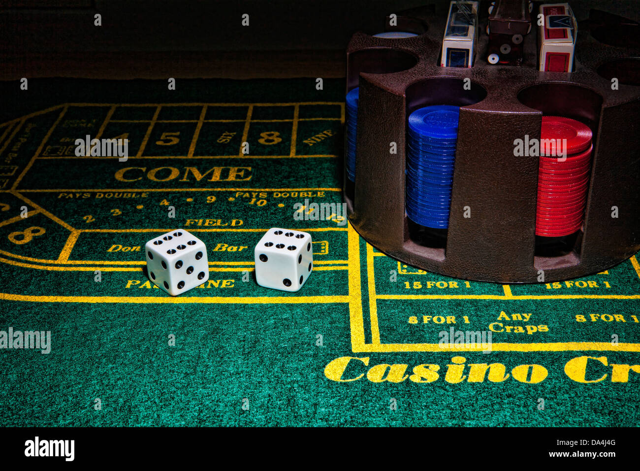 green craps table with dice and chips - Stock Image