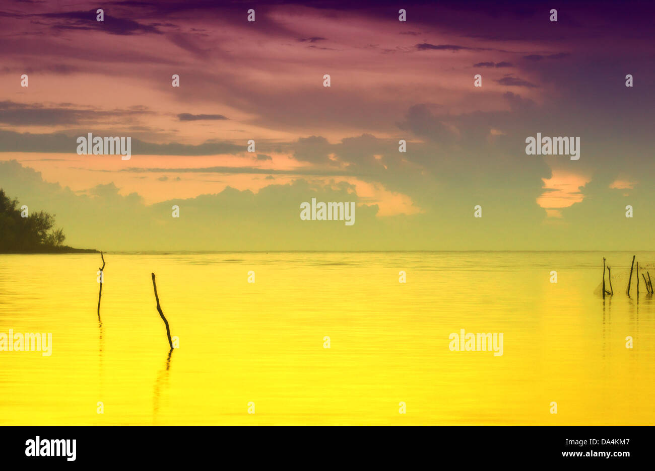 Sunset in Vanuatu with golden sea - Stock Image