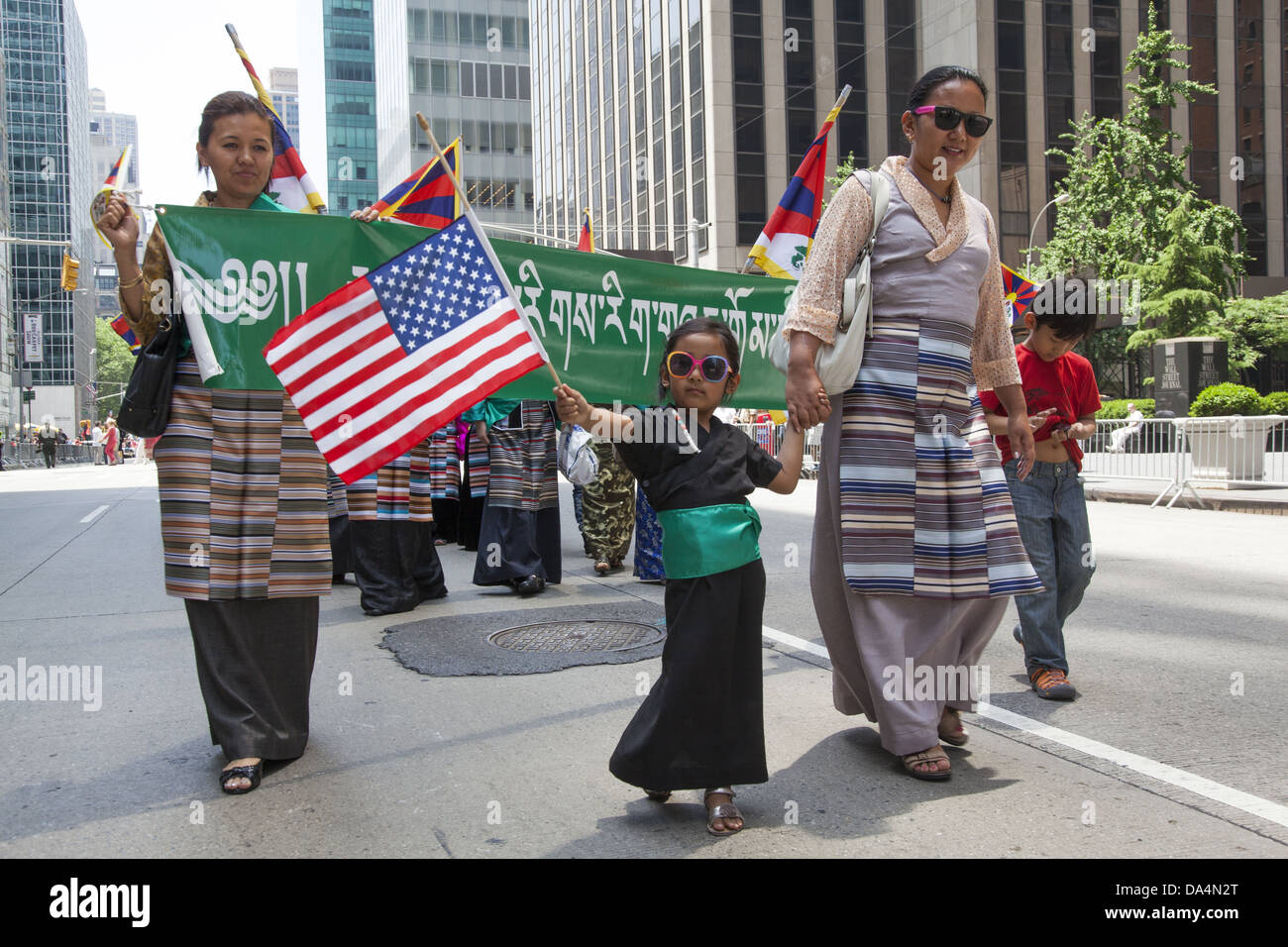 Tibetan refugees and & full fledged Tibetan Americans march in the International Immigrants Day Parade in New - Stock Image