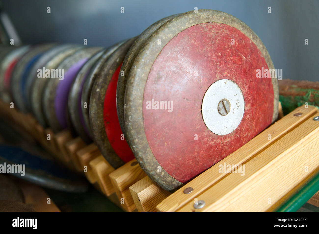 A discus rack of athletics equipment - Stock Image