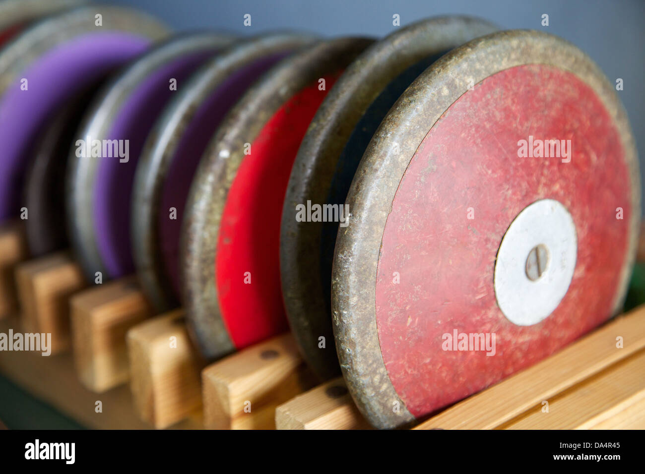 A discus rack at an athletics track - Stock Image
