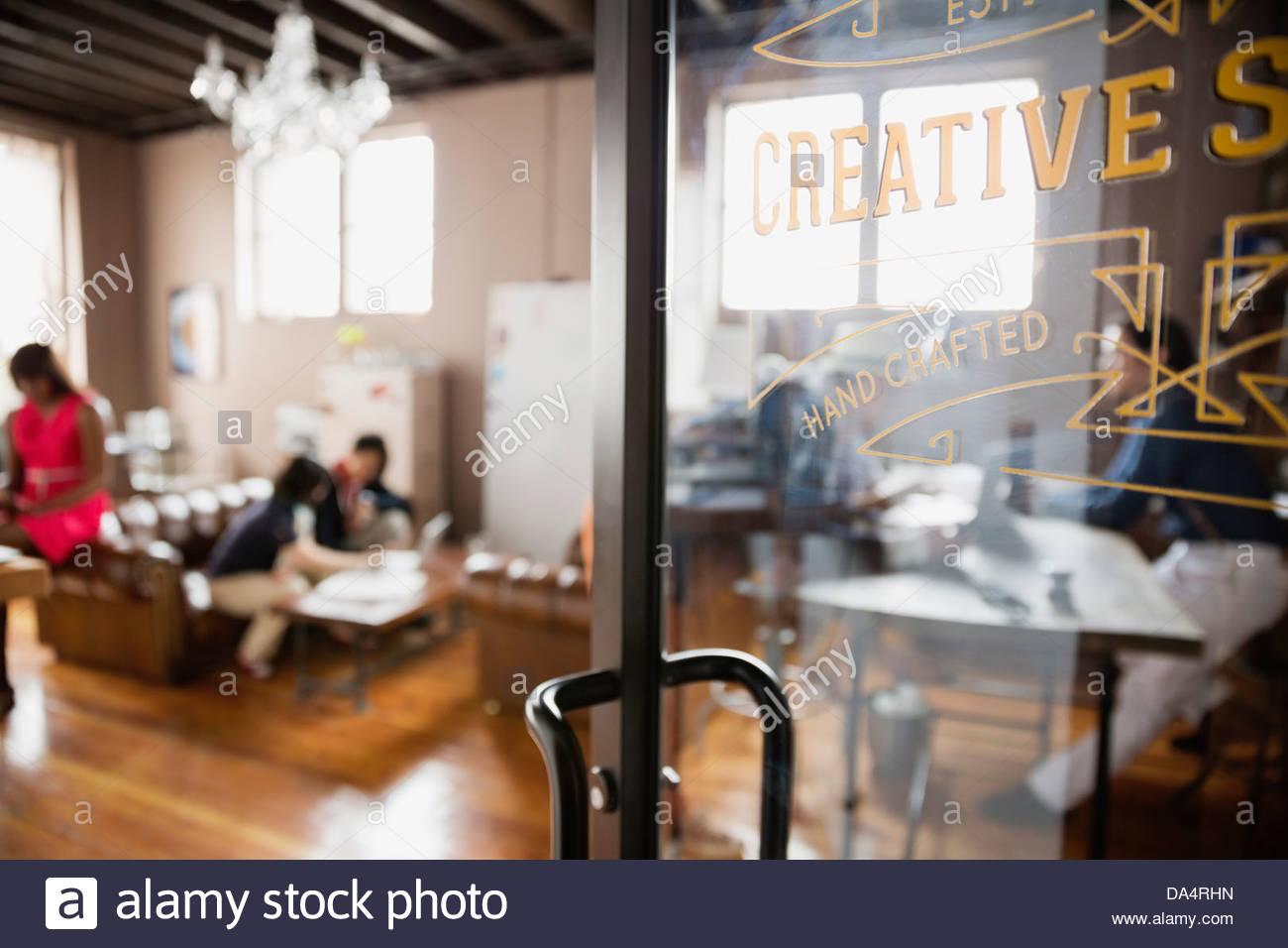 Close-up of door in creative office space - Stock Image
