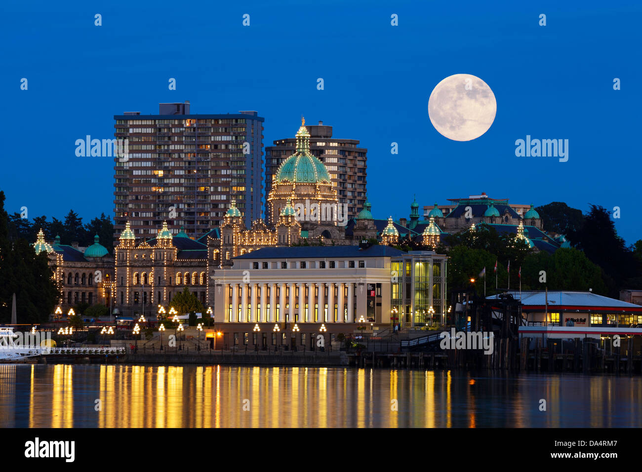 Full moon rising above Provincial Legislature and Inner harbor-Victoria, British Columbia, Canada.  Note-Digital - Stock Image