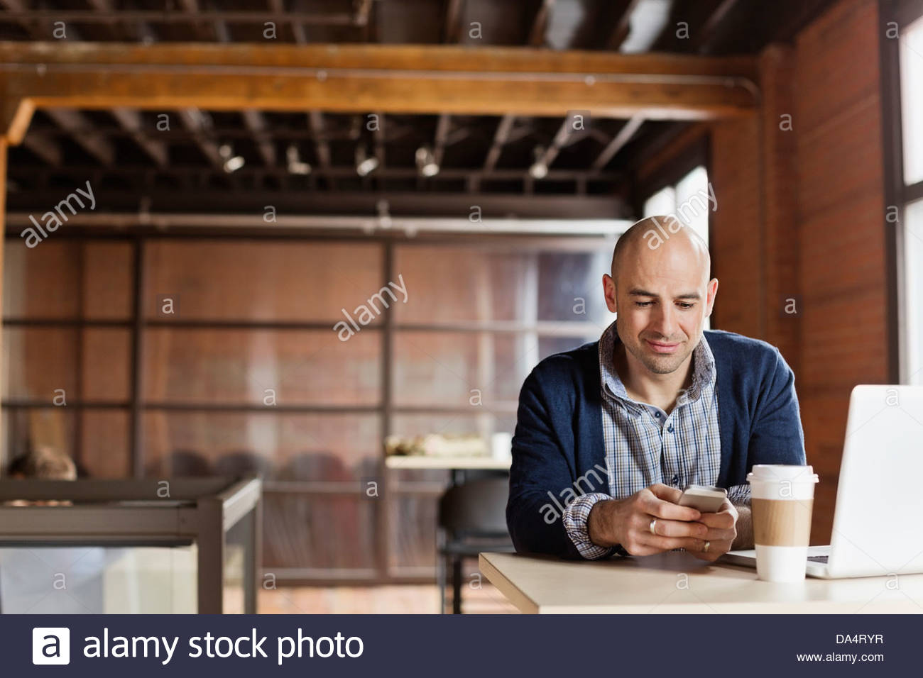 Entrepreneur working in creative office space - Stock Image