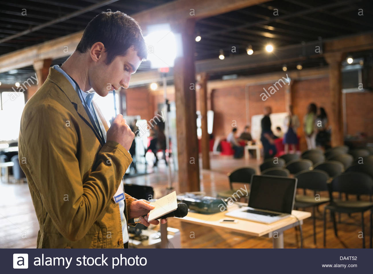 Entrepreneur preparing for presentation in conference room - Stock Image