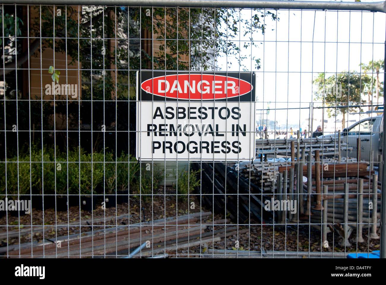 Signage warning of danger due to asbestos removal, Circular Quay, Sydney, Australia - Stock Image